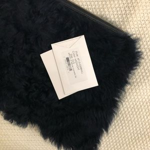3.1 Phillim lim real fur Clutch